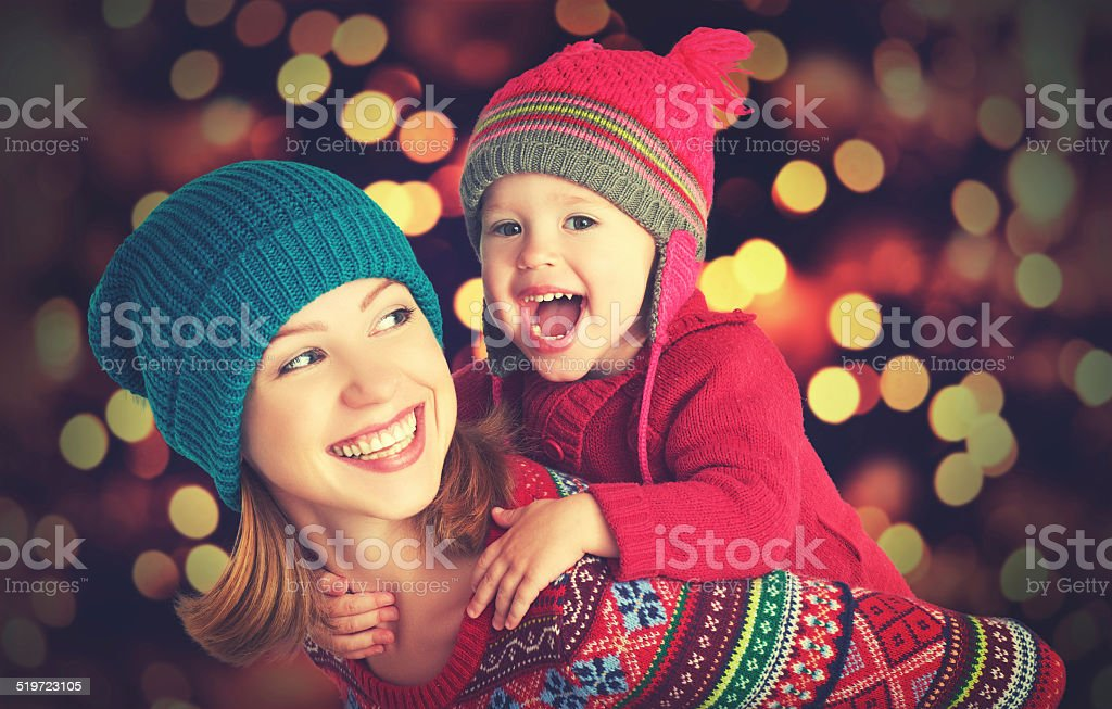 happy family mother, little daughter playing in winter for Christmas stock photo