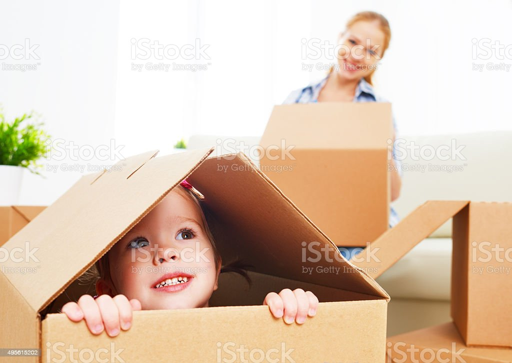 happy family moves into a new apartment. stock photo