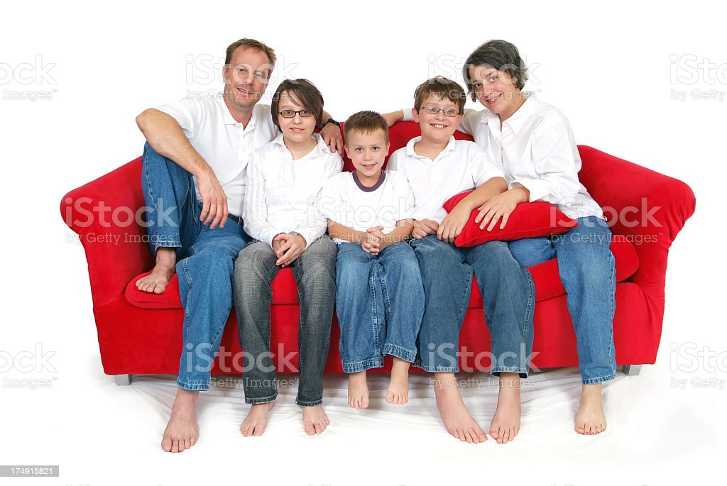 Happy Family of Five Sitting on a Big Red Couch royalty-free stock photo