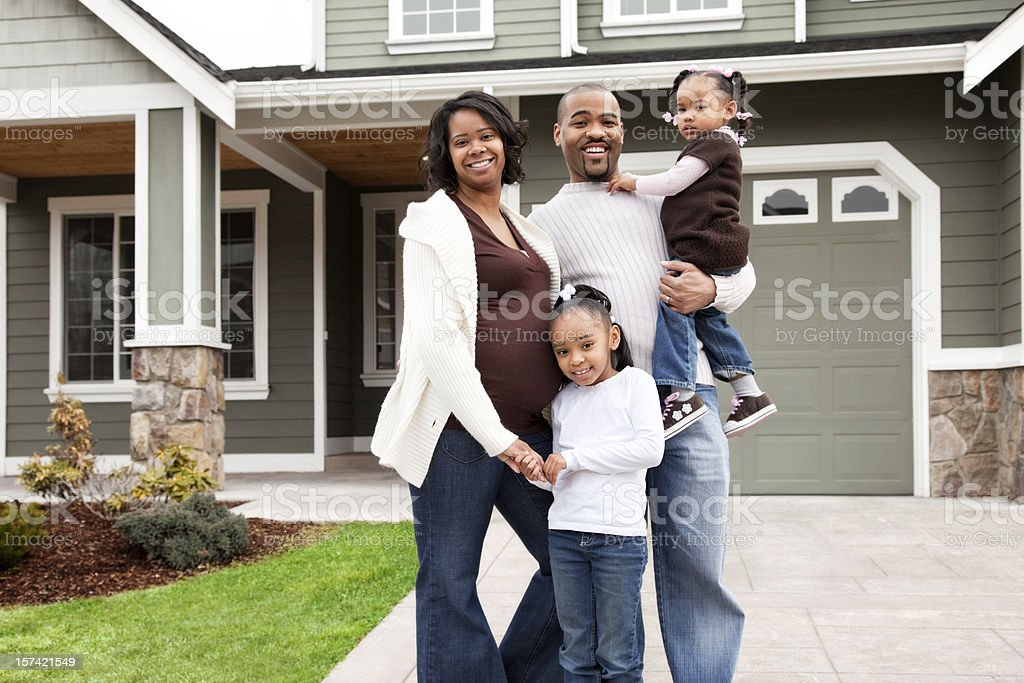 Happy Family of Four at Home stock photo