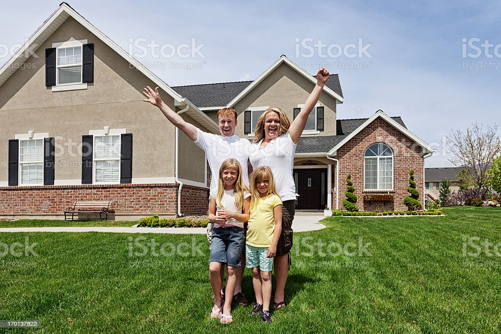 Happy Family of Four at Home royalty-free stock photo
