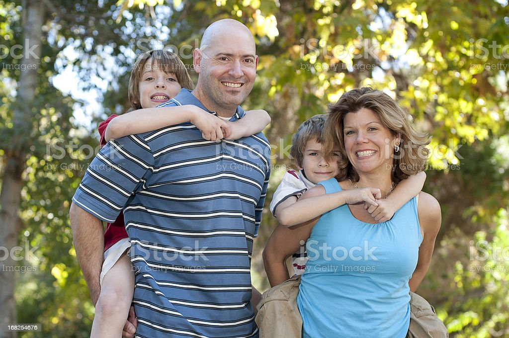 Happy Family of Four At The Park royalty-free stock photo