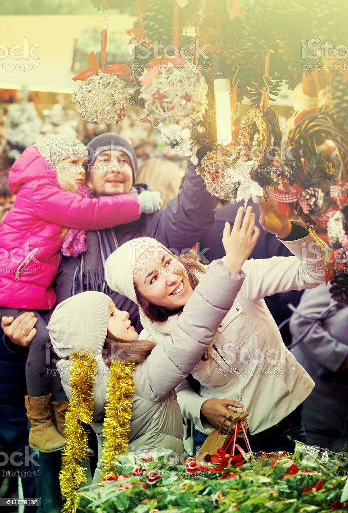Happy family of four choosing floral decorations stock photo