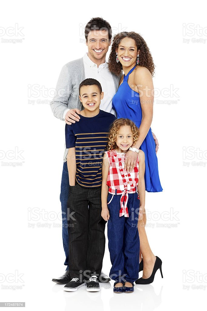 Happy family of four standing together on white royalty-free stock photo