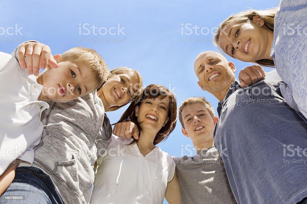 Happy Family of six outdoors on a sunny day stock photo