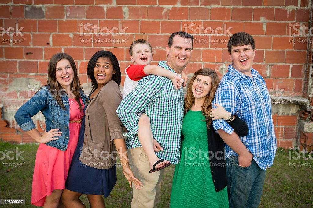 Happy Family of Six Together with Adopted Daughter stock photo