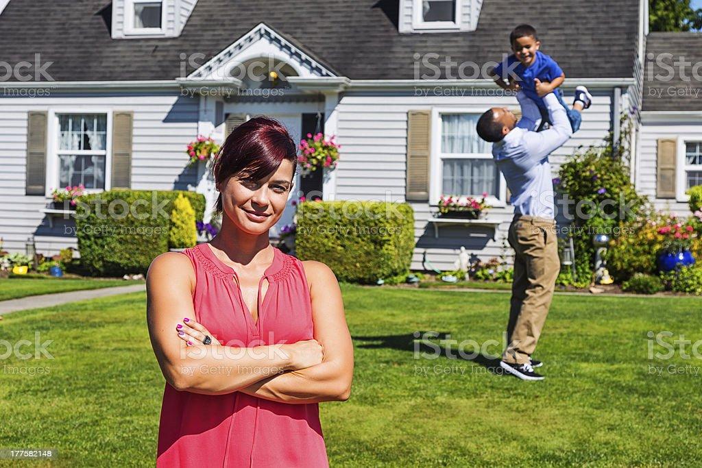 Happy Family of Three at Home royalty-free stock photo