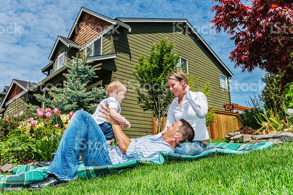 Happy Family of Three at Home stock photo