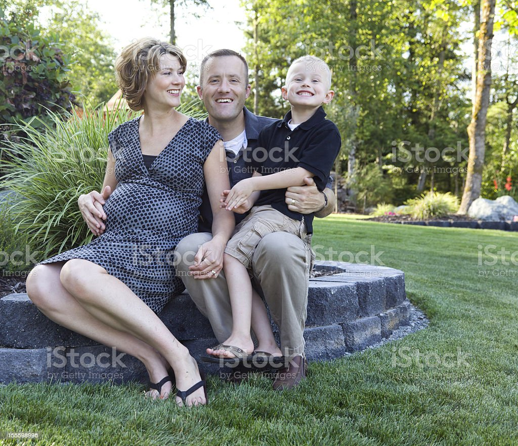 Happy Family of three at home summertime royalty-free stock photo