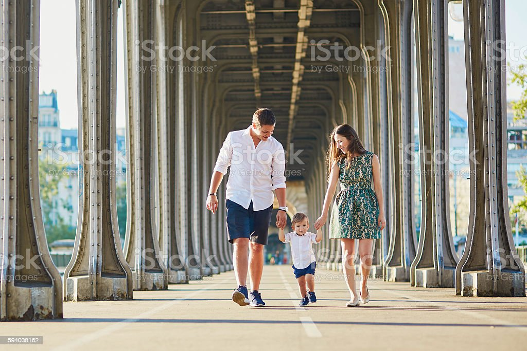 Happy family of three enjoying their vacation in Paris stock photo