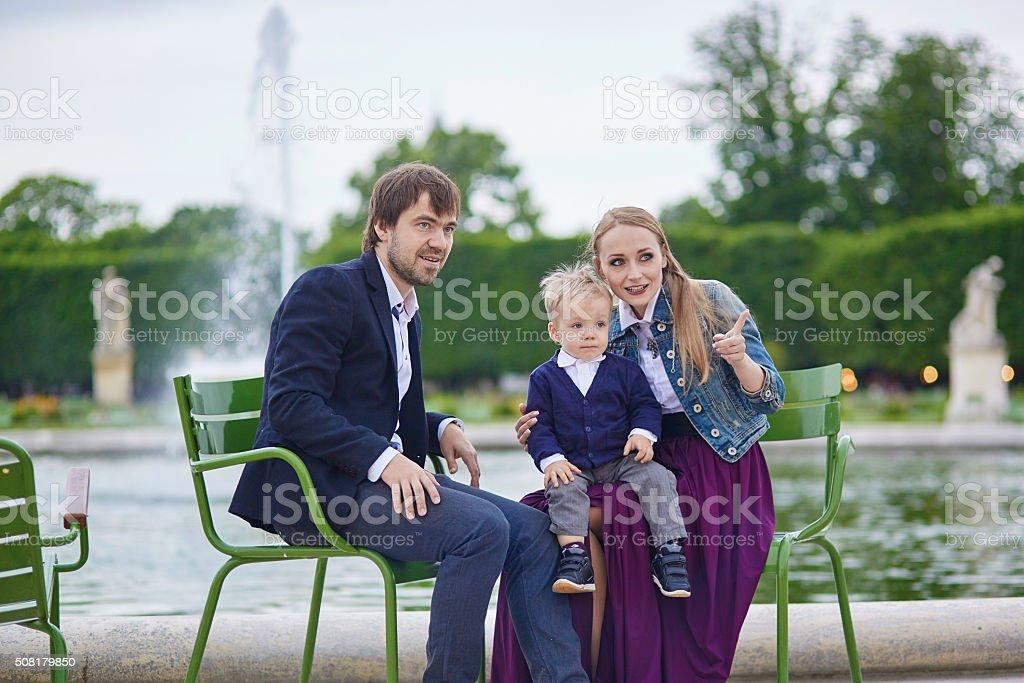 Happy family of three in  Paris stock photo