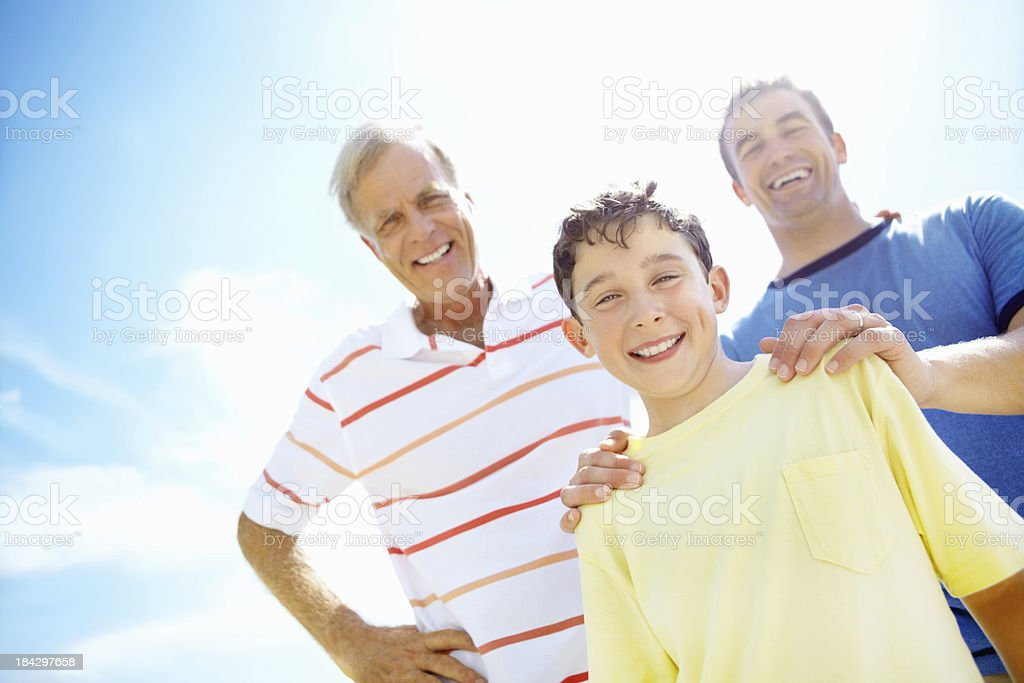 Happy family of three men smiling royalty-free stock photo