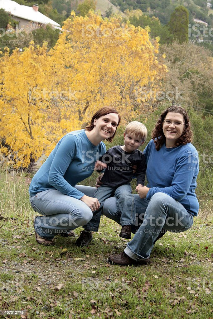 Happy family of three, parents and child royalty-free stock photo