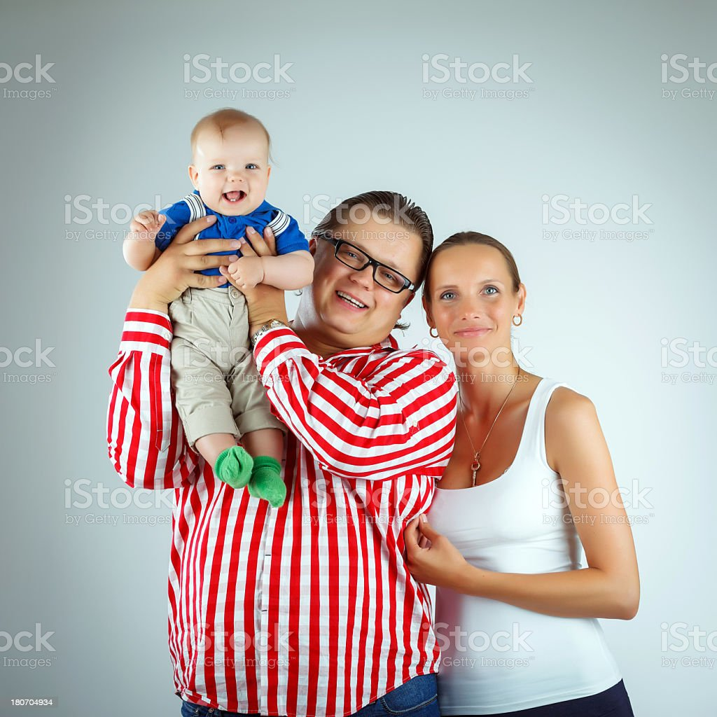 Happy family of three royalty-free stock photo