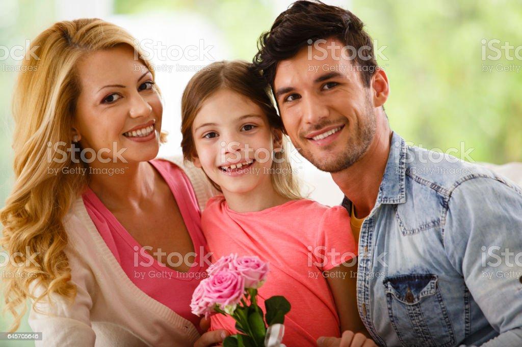 Happy family of three portrait stock photo