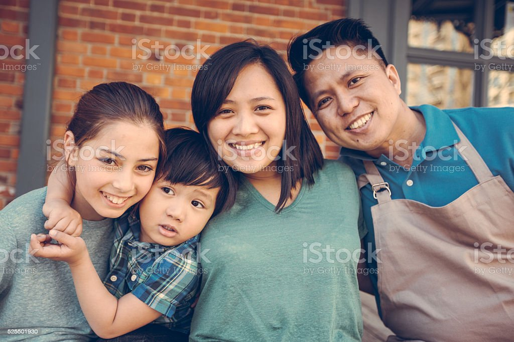 Happy family of young entrepreneurs stock photo