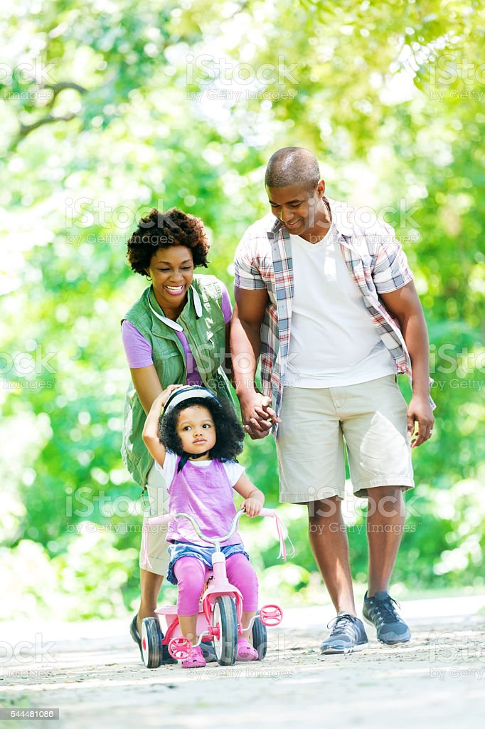 Happy family on a walk in the park together stock photo