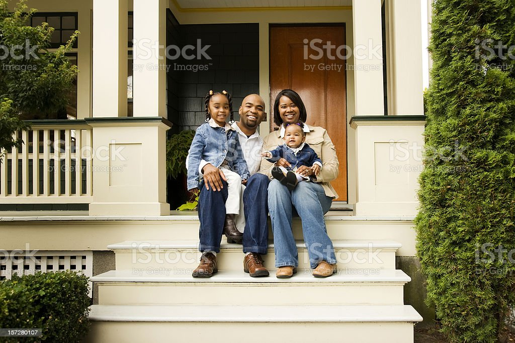 Happy Family on Front Porch royalty-free stock photo