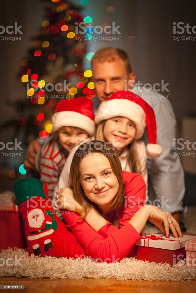 Happy family on New Year's Eve stock photo
