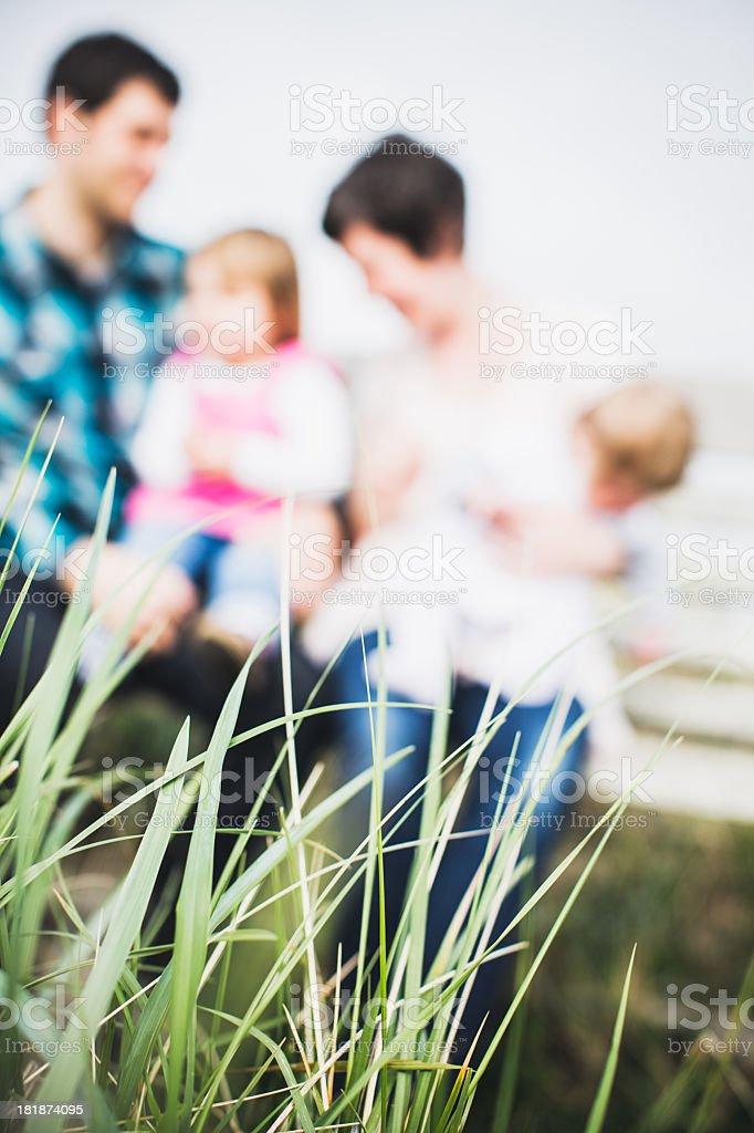 Happy Family on Park Bench royalty-free stock photo
