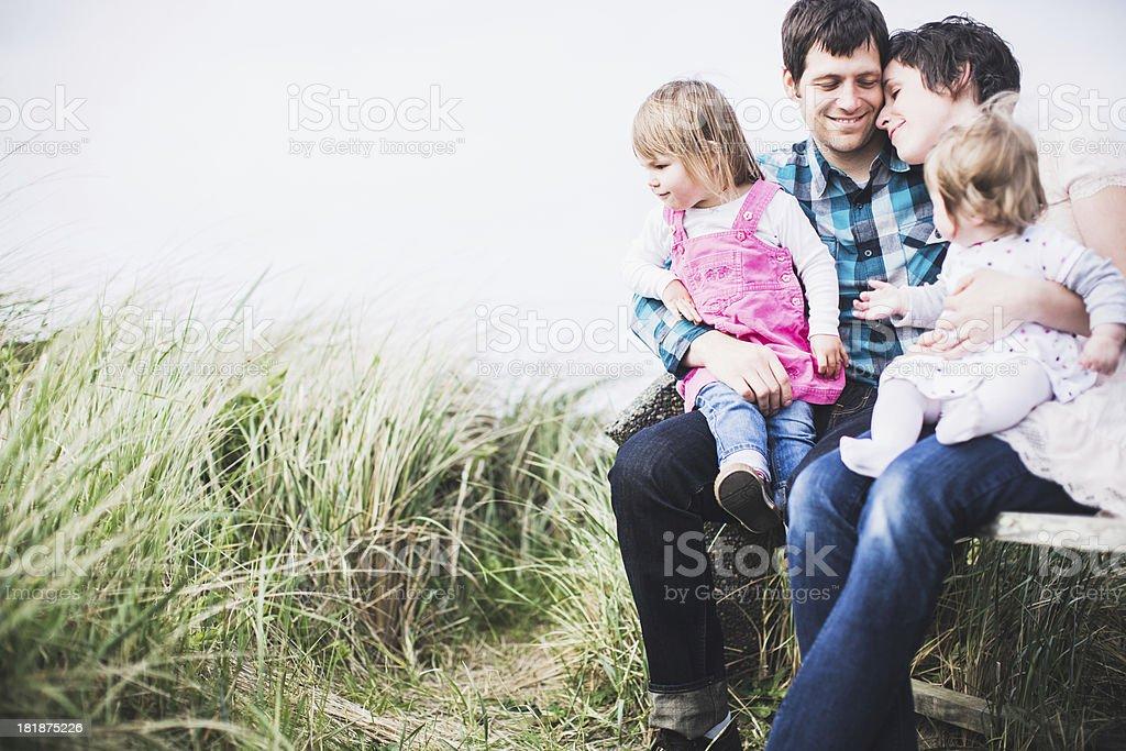 Happy Family on Park Bench stock photo
