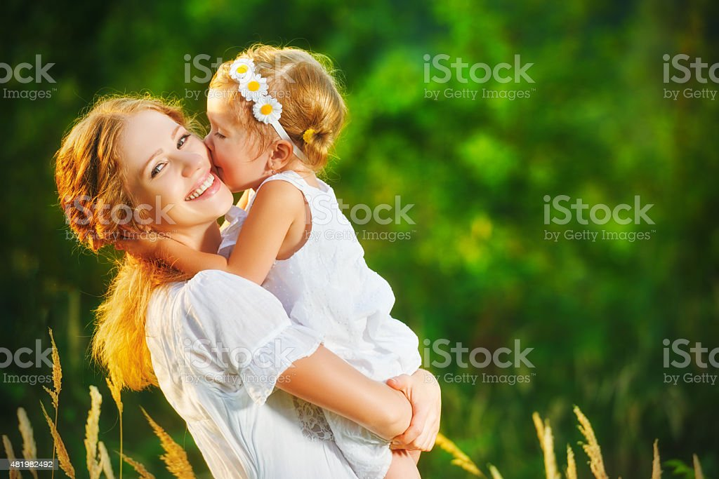 Happy family on summer. little girl child baby daughter hugging stock photo