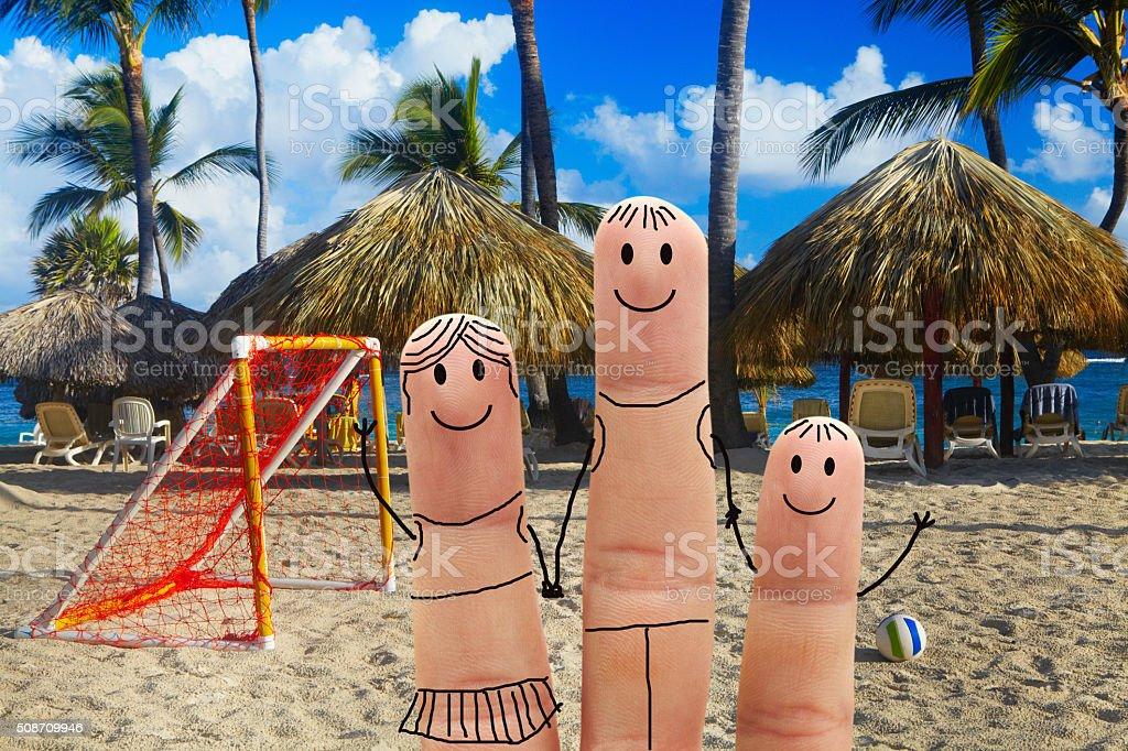 Happy family on the beach. Beachfront football stock photo