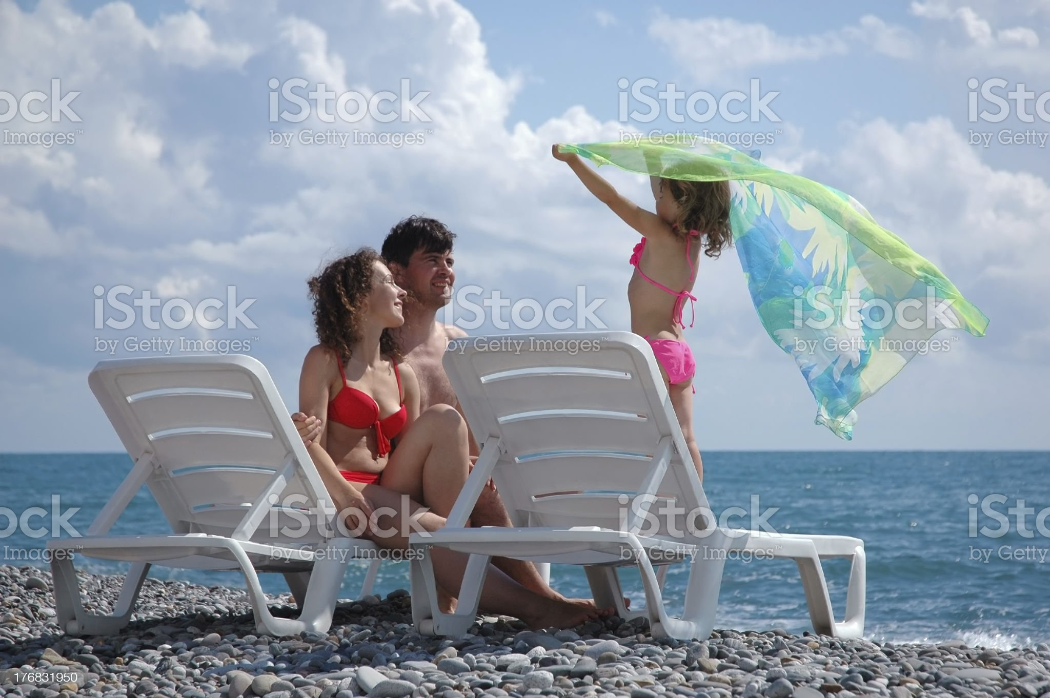 Happy family on the beach royalty-free stock photo