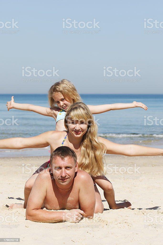 Happy family on the beach royalty-free stock photo