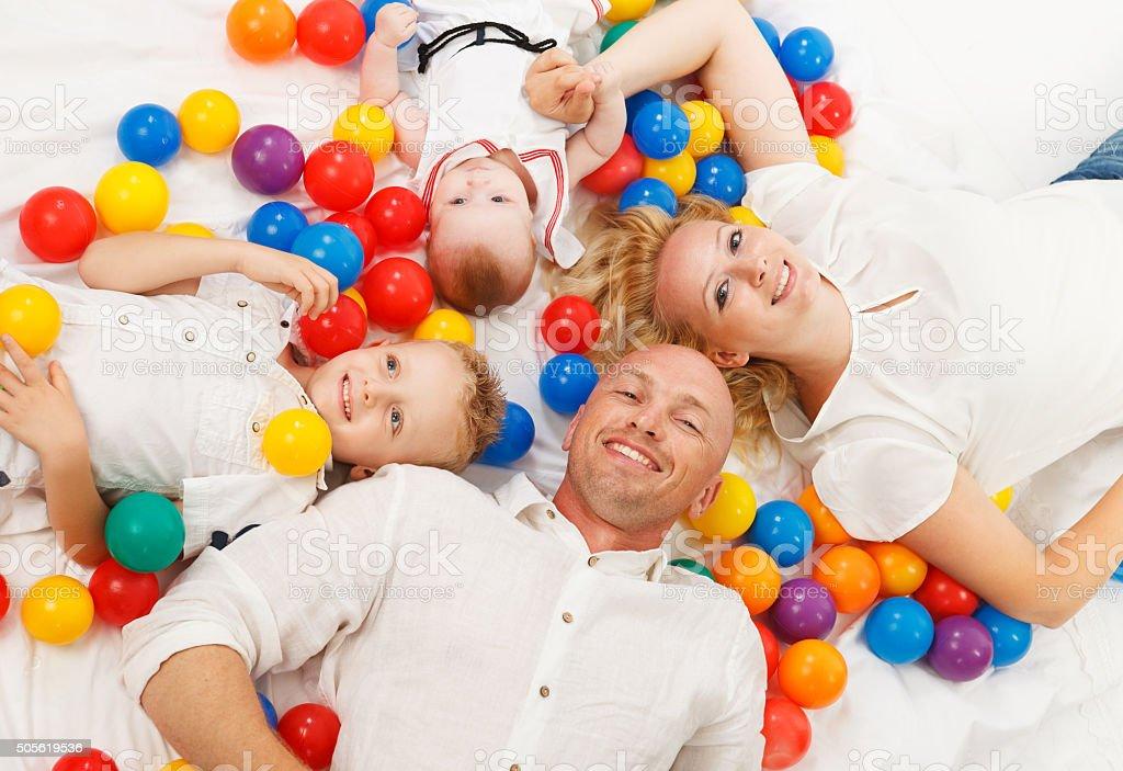 Happy family on the floor stock photo