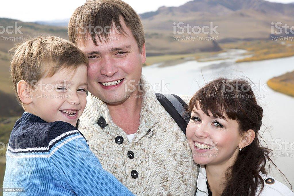 happy family on the mountain with lake stock photo