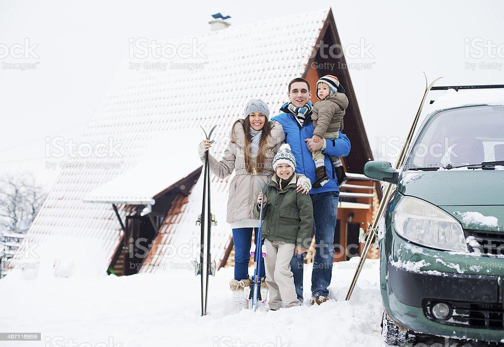 Happy family on winter vacation stock photo