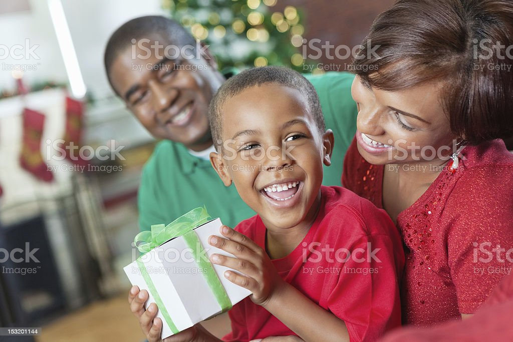 Happy family opening presents together on Christmas morning royalty-free stock photo