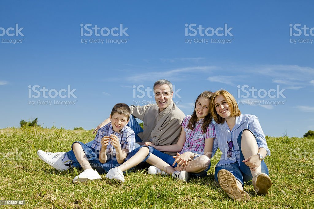 Happy family out in the country. royalty-free stock photo