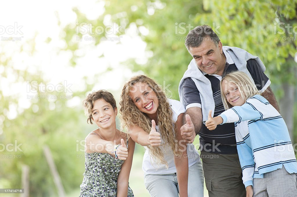Happy Family Outdoor with Thumbs Up royalty-free stock photo
