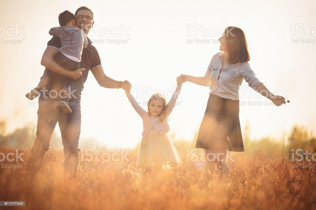 Happy family outdoors having fun stock photo