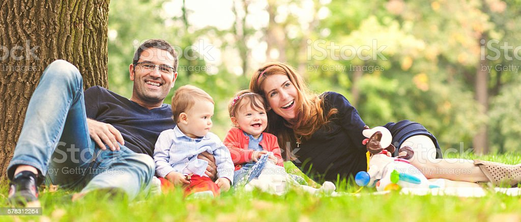 Happy family outdoors in nature laughing stock photo