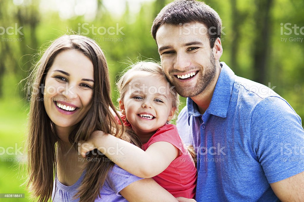 Happy family outdoors stock photo