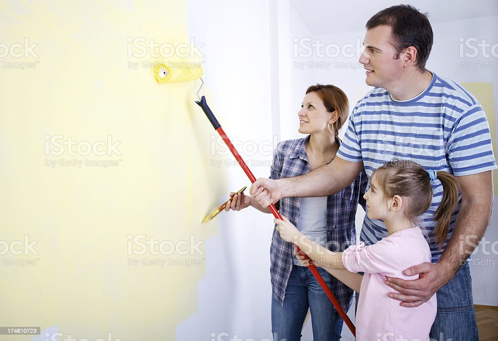 Happy family painting the wall royalty-free stock photo