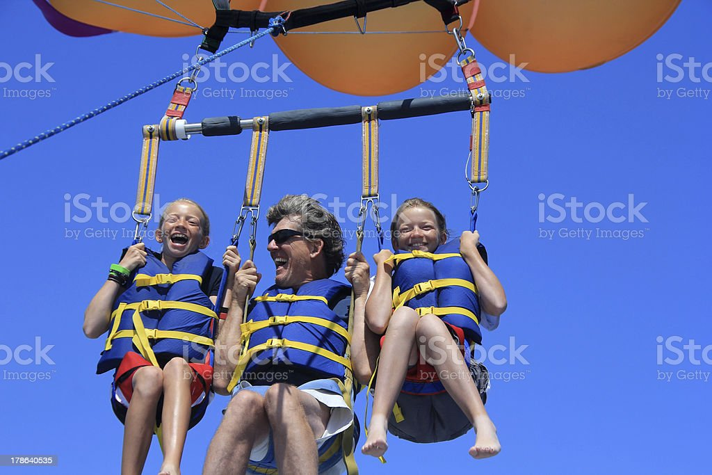 Happy Family Parasailing stock photo