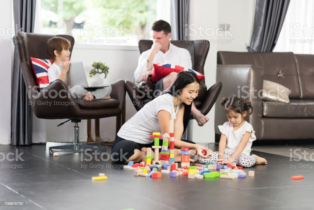 Happy family play with toy stock photo