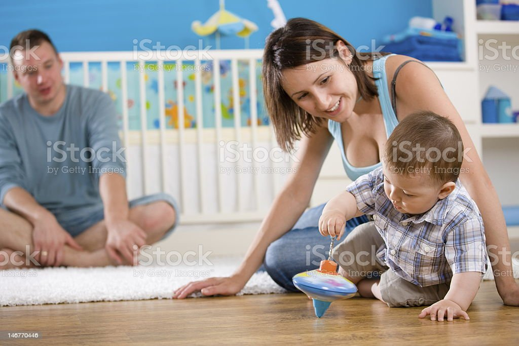 Happy family playing at home stock photo