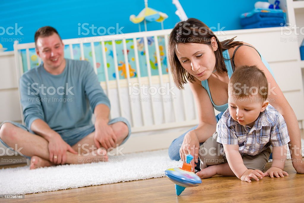 Happy family playing at home royalty-free stock photo