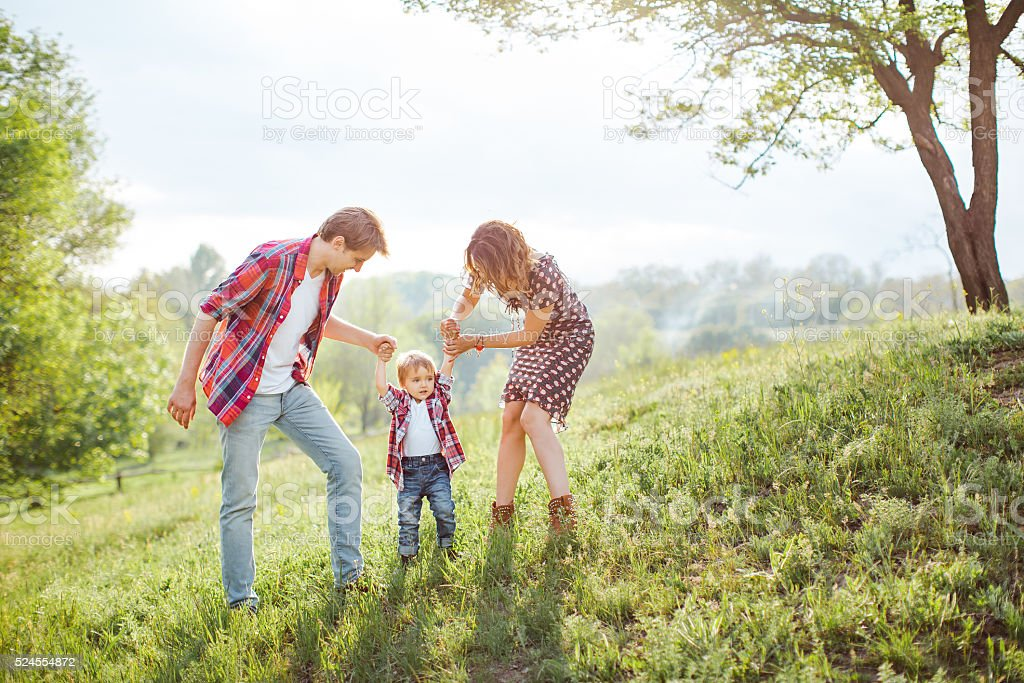 Happy Family Playing on the Nature stock photo