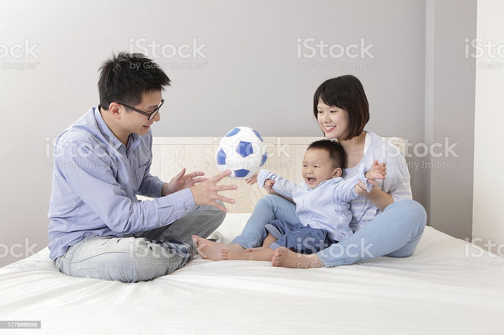 happy family playing toy soccer stock photo