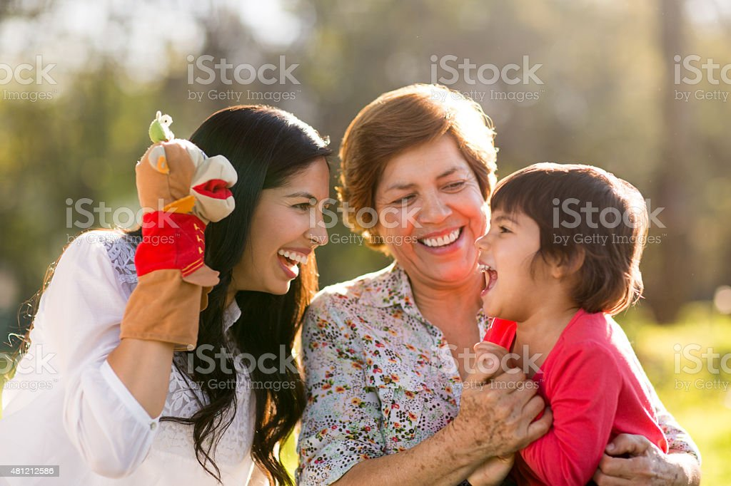 Happy family playing with a puppet stock photo