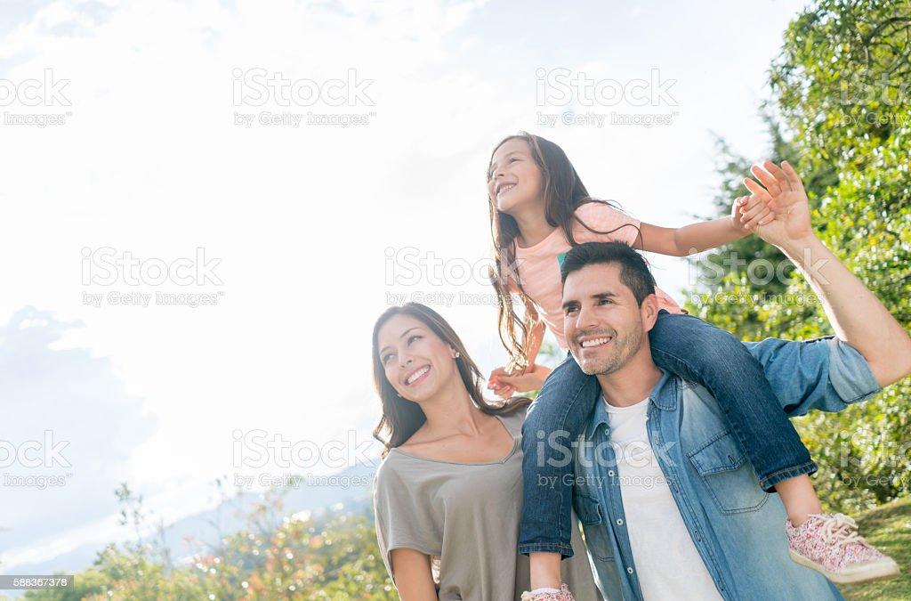 Happy family portrait at the park stock photo