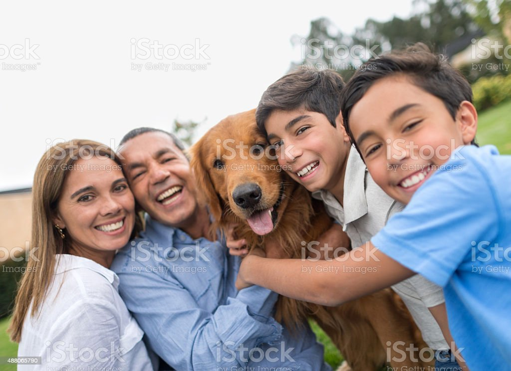 Happy family portrait with a dog stock photo