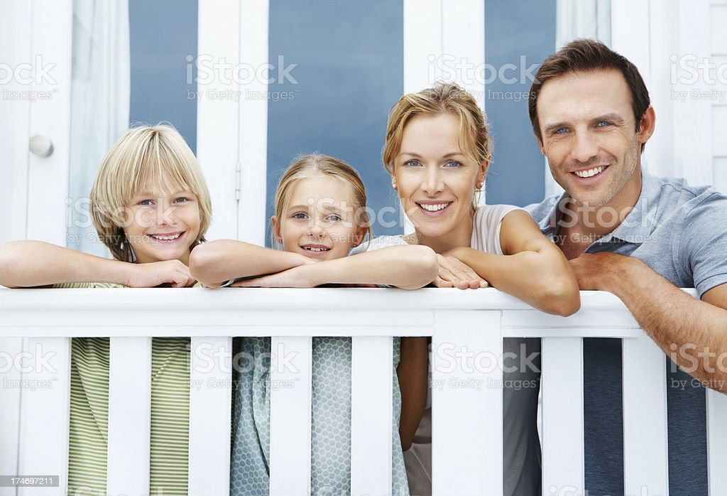 Happy family posing at railing royalty-free stock photo