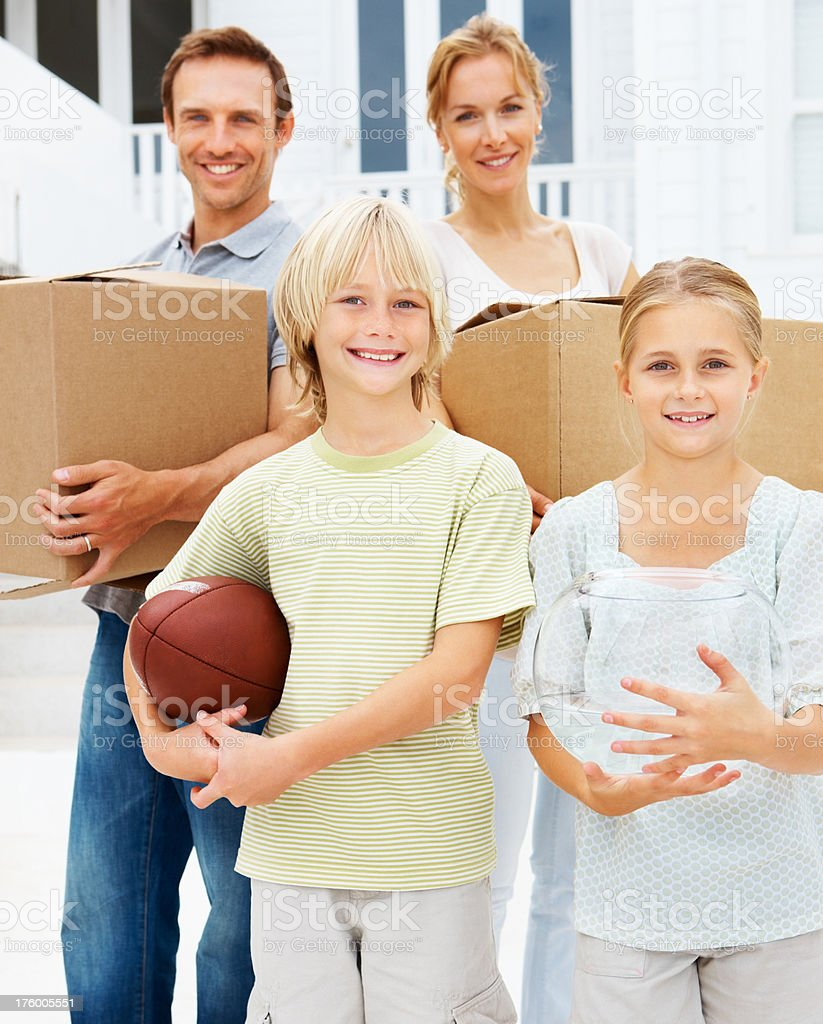 Happy family posing while shifting their house royalty-free stock photo